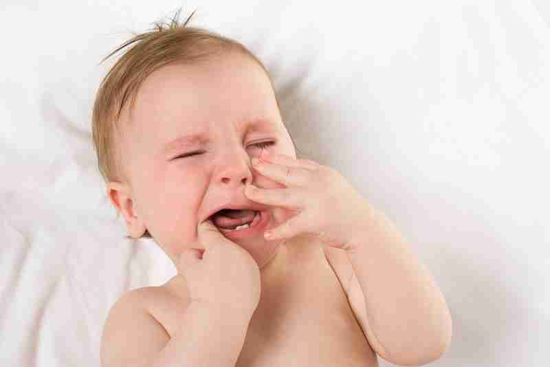 why does teething hurt